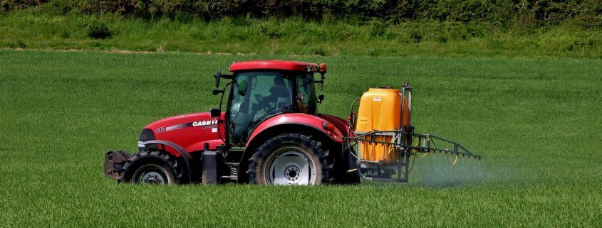 Tractor spraying herbicides